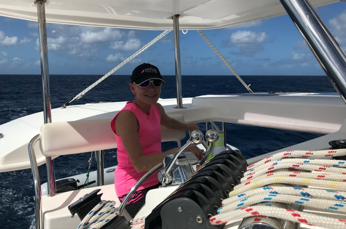 8_Woman-at-helm_700x465